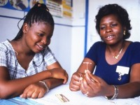 Kenyan women learning about IUDs. Photo credit: MSI