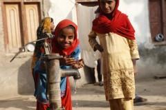 Children in Sindh, Pakistan, play at a water pump. Photo credit: Georgetown Public Policy Review