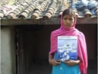 During EIG's entrepreneurial literacy course, Sitara learned how to read and write, and how to use a calculator. She also learned about proper nutrition, peace-building, and how to access loans, credits, and other government services. Photo credit: Winrock International