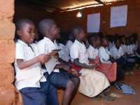 Children reading in the Democratic Republic of Congo. Photo Credit: Alain Mukeba USAID/DRC