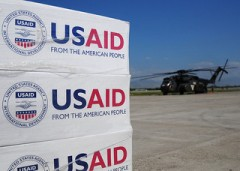 Pallets of USAID-supplied food, water and supplies. Photo credit: USAID
