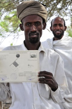 Ato Abdela displays the kaartaa certifying his, along with his wife's, rights to their parcel of land in Oromia, Ethiopia. Photo credit: Gregory Myers, USAID