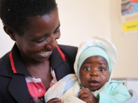 Baby receives health services. Photo credit: USAID