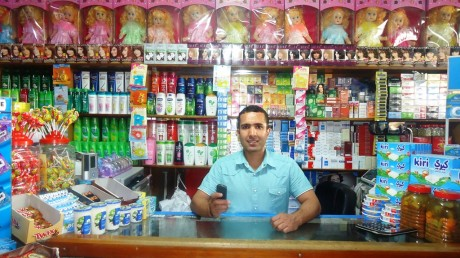 Omar, who owns a supermarket in Kabul, uses M-Paisa for most of his transactions. Photo credit: USAID/Afghanistan