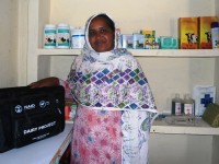 Livestock extension worker Bushra Yasmeen poses in her clinic in Pir Mahal in Pakistan's Punjab province. Bushra received training and basic supplies from USAID's Dairy Project  Photo credit: USAID Dairy Project