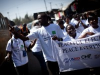 A group of Kenyan youth marching for peace before the general elections in March 2013. Photo credit: USAID/Kenya