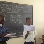 Student and teacher in Liberia. Photo credit: GPE