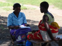 A community health worker in Malawi counsels a woman on her family planning options at a gathering place in her community. USAID works in more than 45 countries around the globe to increase access to family planning information and services for all who want them. Photo credit: Liz Bayer