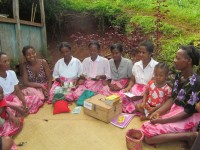 Philomène (4th from left) volunteered to keep the VSL association's books Photo credit: CARE International/Madagascar