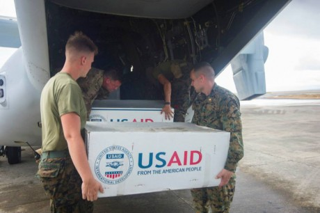 Hospital Corpsman 3rd Class Eric Chiarito, from Hyde Park, N.Y., left, and Marine Sgt. Jonathan Thornton, from Lake Havasu, Ariz., load supplies to assist the Philippine government in response to the aftermath of Super Typhoon Haiyan/Yolanda. Photo credit: U.S. Navy.