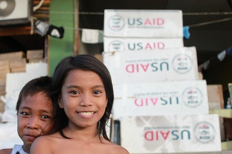 This photo was taken in hard-hit Tacloban, where USAID, working with UNICEF, has helped repair the municipal water system. Photo credit:  IOM/J. Lowry