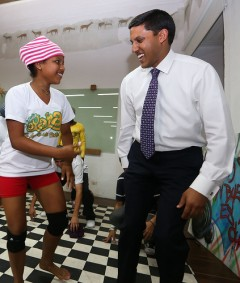 USAID Administrator Rajiv Shah dances with a Family Ayara Youth Foundation dancer in a trip to Bogota, Colombia in April 2013. Photo credit: USAID