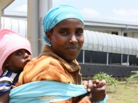 Mother and child at a health clinic in Ethiopia. Photo credit: USAID