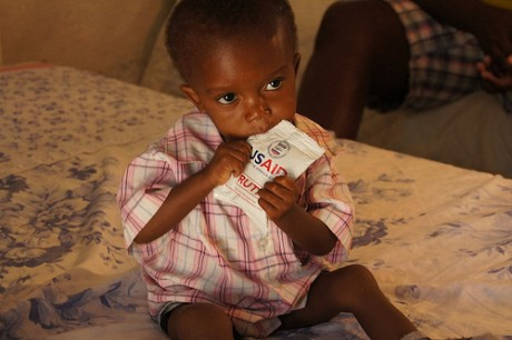A child eats food delivered by USAID. Photo Credit: USAID