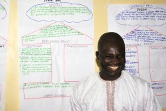 Alfa Ndatsu from Gwako Health Center, presenting his team work on the challenge model during LDP+ training. Photo: Lourdes de la Peza