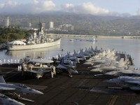 Sailors man the rails as the aircraft carrier USS Nimitz (CVN 68) enters Pearl Harbor. Nimitz is in Pearl Harbor for a scheduled port visit during their transit home after an eight-month deployment to the U.S. 5th, 6th, and 7th Fleet areas of responsibility.