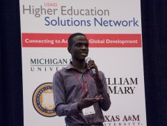 Brian Gitta, from Makerere University in Uganda pitches his winning idea that uses cell phones and light – not needles and blood samples to test for malaria. Photo Credit: Cynthia Kao-Johnson/USAID