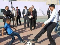 Deputy Assistant Administrator Romanowski and Administrator Rajiv Shah play soccer with a student at the Az Zeer school in Harmala. Click to view more photos from the visit to the Middle East
