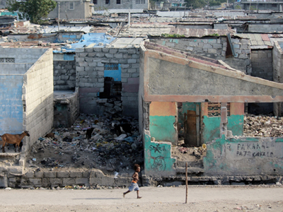 A row of damaged houses and buildings in the Cité Soleil neighborhood in Port-au-Prince, Haiti. Four years after the disaster, almost 75 percent of earthquake rubble has been removed and 89 percent of the 1.5 million displaced population have left camps for alternative housing options.
