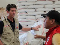 """[caption id=""""attachment_26240"""" align=""""alignright"""" width=""""240""""] Deputy Assistant Administrator Greg Beck discussing continuous Typhoon Haiyan/Yolanda relief operations with a DSWD representative Photo credit: USAID.[/caption]"""