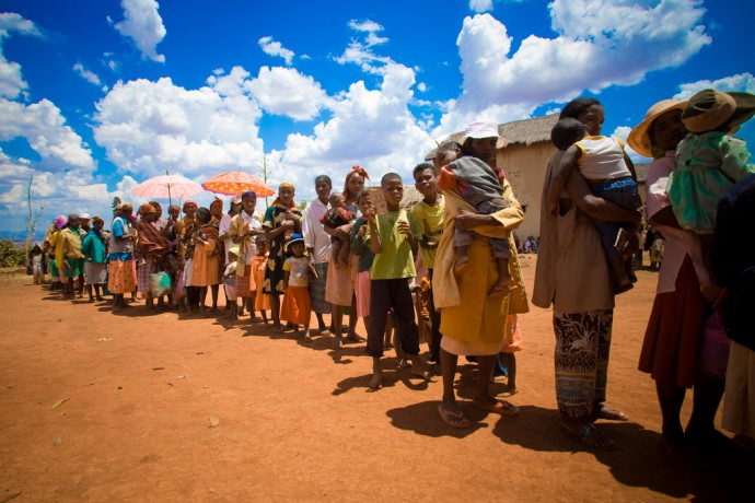 In Madagascar, people line up to receive insecticide-treated bednets and treatment. Photo Credit: Maggie Hallahan