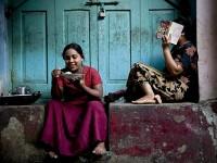 A woman eats rice a on a street in Rangoon