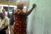 Ms. Namuhindo demonstration her new writing skills. / Rachel Grant, USAID