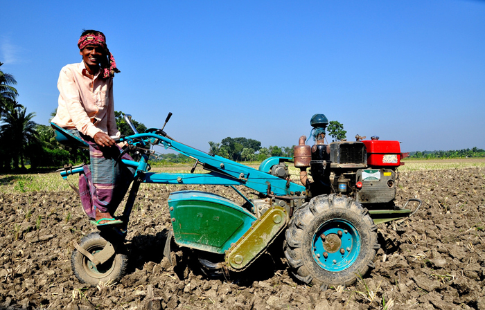 """This modern technology reduces my time in the field. Before, I used traditional methods. I needed more people to work during planting and harvesting. That increased my production cost. But now, I use this machine and I make more profit,"" says this farmer in southern Bangladesh. /USAID, Wasif Hasan"
