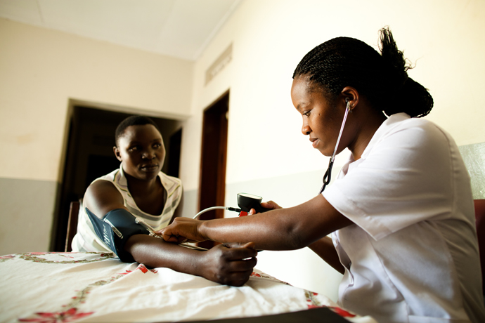 A nurse works in southwest Uganda's Kabwohe Clinical Research Center, a facility that received a $35,000 loan guaranteed through USAID's Development Credit Authority, and was able to hire more staff and provide life saving AIDS treatment to 4600 patients as a result. / USAID, Morgana Wingard