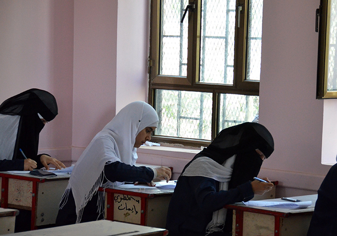 Girls at the newly refurbished Al-Jeel Al-Jadeed School in Sana'a, Lebanon, begin their exams on test day. Recent USAID improvements to the infrastructure and teaching practices have opened the doors for more girls to attend school and receive an education.