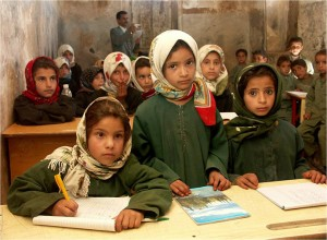 School girls in Sana'a gather for their lesson. Since many girls in Yemen do not attend primary school or graduate from it, recent USAID-backed measures have ensured all girls a right to attend school and increase literacy.