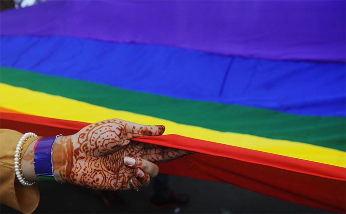 A gay rights activist holds a rainbow flag during a Rainbow Pride rally in Kolkata on July 15, 2012.