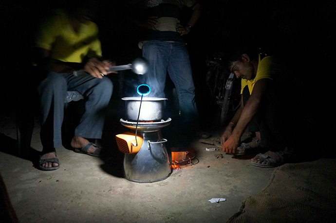 BioLite conducts a nighttime training on its low-cost biomass Homestove