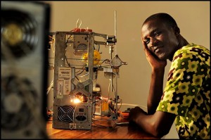 WoeLab inventor Afate Gniko with his e-waste 3D printer. / woelabo.com