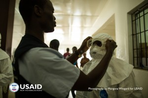 Health care workers put on Personal protective equipment (PPE) before going into the hot zone at Island Clinic in Monrovia, Liberia on Sept 22 2014. / Morgana Wingard, USAID