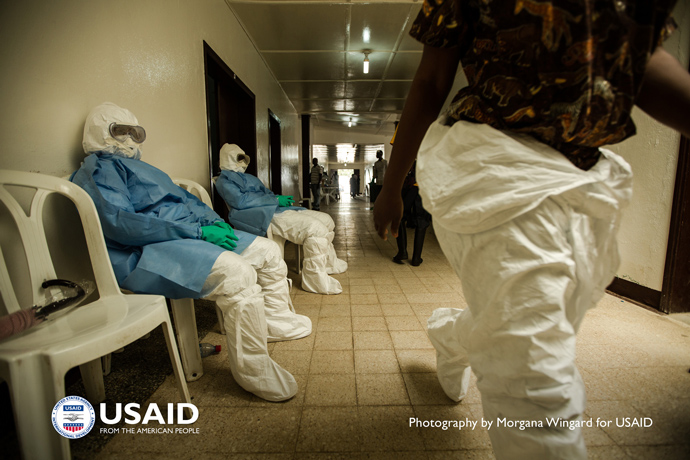 Health workers in personal protective equipment (PPE) wait to enter the hot zone at Island Clinic in Monrovia, Liberia on Sept 22. 2014. PPE is their primary protection, but it is also the greatest source of stress