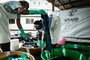 Washing is a vital part of the operation of the Ebola Treatment Unit at Island Clinic in Monrovia. All scrubs worn under PPEs and shoes must be washed thoroughly in chlorine water and then with soap. / Morgana Wingard