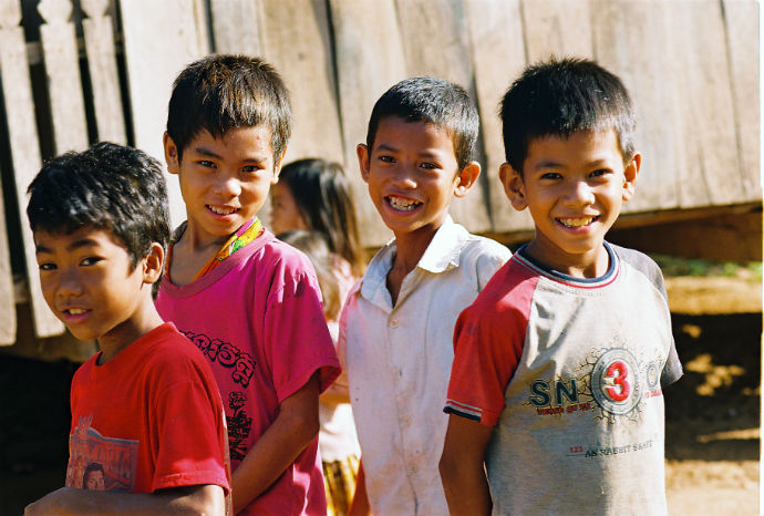 Children outside of the health center in Kampong Thom province in Cambodia, where oral re-hydration therapy is provided to children who have diarrhea. PATH/Heng Chivoan
