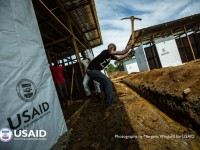 With funding and support from USAID, construction crews work quickly to build a new Ebola treatment unit in Monrovia, Liberia, in front of the former Ministry of Defense building, Oct. 1, 2014