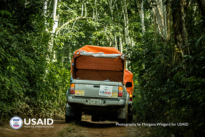 Pick-up trucks-turned-ambulances drive hours through dirt roads in Bong County, Liberia, to collect patients, Oct. 9, 2014