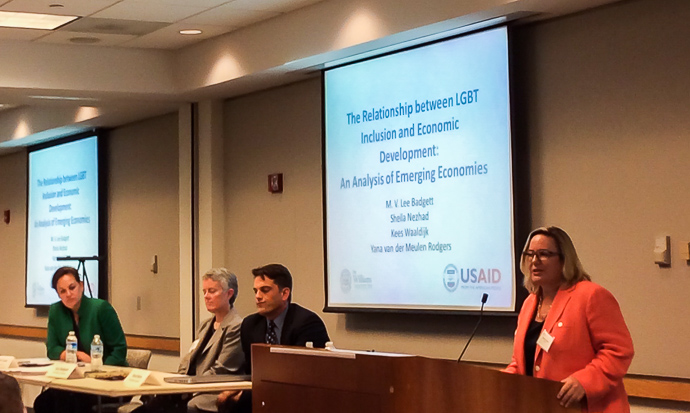 Dr. Claire Lucas, USAID's senior adviser on partnerships, addresses the audience at the launch of the joint Williams Institute-USAID report on LGBT inclusion and economic development. Seated, left to right: Carla Koppell, chief strategy officer, USAID; M.V. Lee Badgett, report author and research director, Williams Institute; and Brad Sears, executive director, Williams Institute. Photo credit: Matthew Corso/USAID