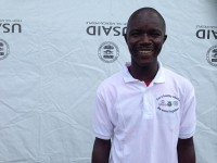 """Tejanie Golafaley, an Ebola survivor, saw it as his personal mission to work at the USAID-supported Ebola treatment unit in Tubmanburg. """"I want to explain my story to patients [so that] they can start to take courage."""" / Carol Han, USAID/OFDA"""