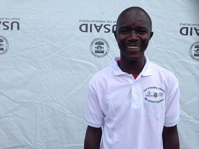 "Tejanie Golafaley, an Ebola survivor, saw it as his personal mission to work at the USAID-supported Ebola treatment unit in Tubmanburg. ""I want to explain my story to patients [so that] they can start to take courage."" / Carol Han, USAID/OFDA"