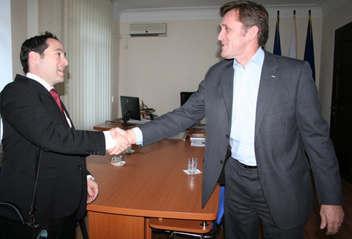USAID Deputy Assistant Administrator Jonathan Katz (left) shakes hands with Iurie Ciocan, the head of Moldova's Central Election Committee.