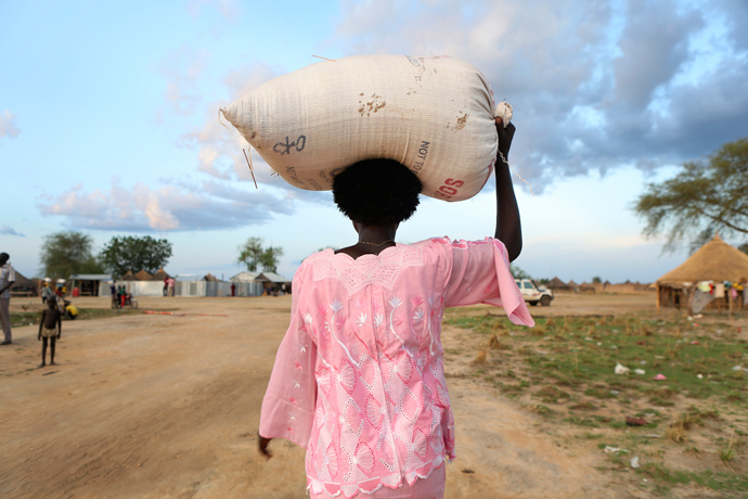 Mary Ngok, 31, a farmer in Bor County receives sorghum, oil, and lentils in exchange for road construction work they completed as part of the Catholic Relief Services led Jonglei Food Security Program, JFSP, in Jonglei, South Sudan. / Sara A. Fajardo/Catholic Relief Services