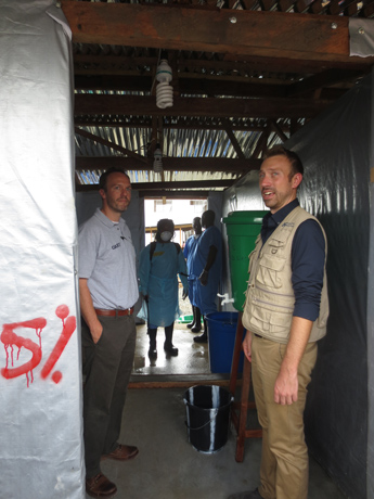 USAID is funding International Medical Corps (IMC) to operate the ETU in Kakata. Here, USAID Disaster Assistance Response Team (DART) Deputy Justin Pendarvis (left) gets a tour from IMC Emergency Response Team Director Sean Casey (right). / Alisha McMichael, USAID/OFDA