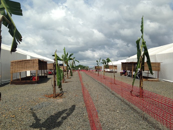 "The facility was built by Save the Children with USAID providing construction materials, gravel, cots for patients, generators to power the ETU, and other support.  The red fencing separates public areas from Ebola ""hot zones."" Photo courtesy: Justin Pendarvis, USAID/OFDA"