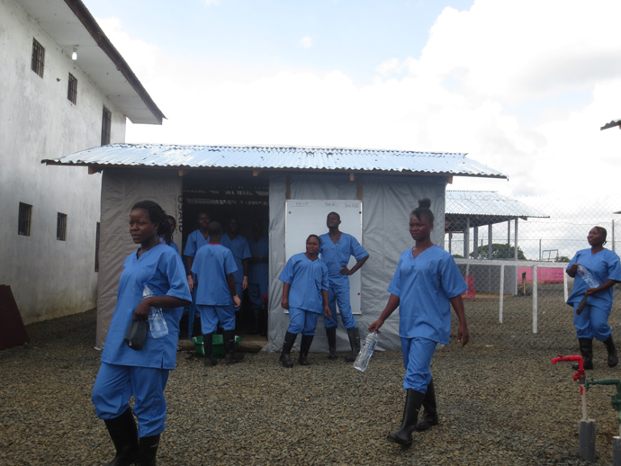 More than 160 people—mostly Liberian national staff—work at the ETU. For the past two weeks, IMC's medical team received rigorous training on Ebola patient care, safety protocols, and ETU management. Photo courtesy: Alisha McMichael, USAID/OFDA