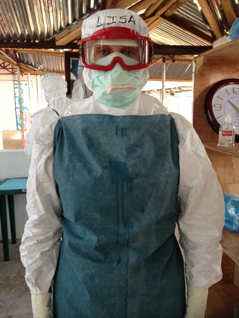 12.4.14-IMC-Dr.-Lisa-Woods-at-Lunsar-ETU-in-middle-of-6-hour-shift-Photo-Carol-Han-USAID-OFDA