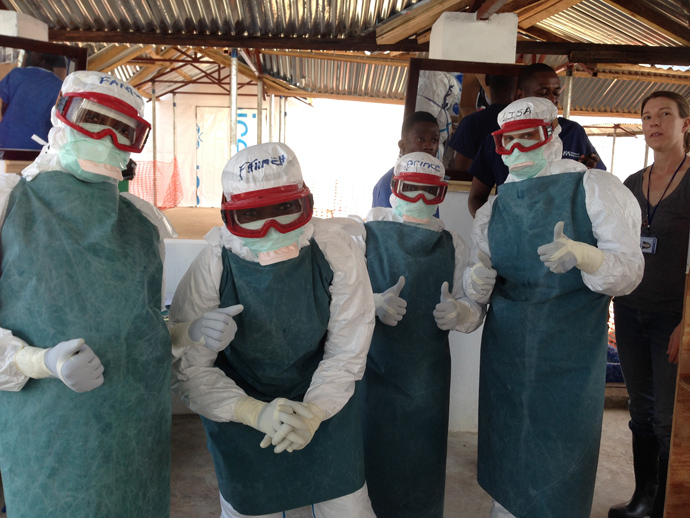 12.4.14-IMC-medical-dream-team-suits-up-for-another-round-in-clinical-ward.-photo-Carol-Han-USAID-OFDA